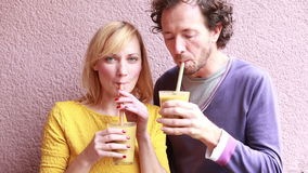 Happy woman drinking smoothie with straw stock video