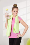Happy woman drinking water after workout Stock Photography