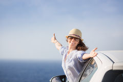 Happy woman driver at the beach Royalty Free Stock Photos