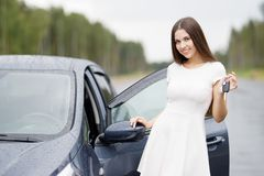 Happy woman driver showing car key Stock Photography