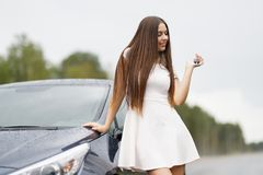 Happy woman driver showing car key Stock Photos