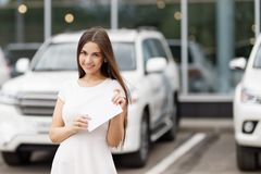 Happy woman driver showing car key Royalty Free Stock Photos