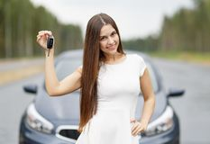 Happy woman driver showing car key Royalty Free Stock Images