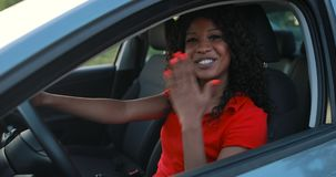 Happy woman driver sitting in car salon waving hand stock video footage