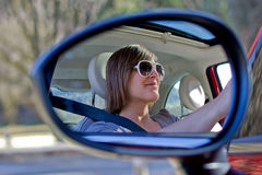 Happy woman driving. The car royalty free stock image