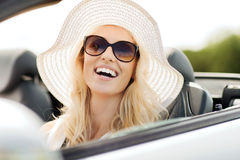 Happy woman driving in cabriolet car Royalty Free Stock Photos