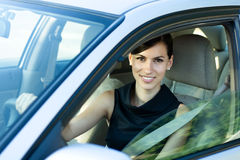 Happy woman driving the car Stock Photos