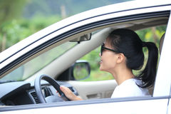 Happy woman driving car Stock Photos