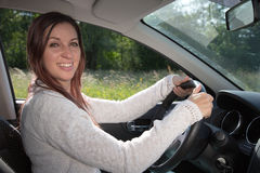 Happy woman driving a car Royalty Free Stock Image