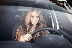 Happy woman driving her car Royalty Free Stock Photography