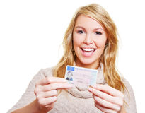Happy woman with driving licence Royalty Free Stock Image