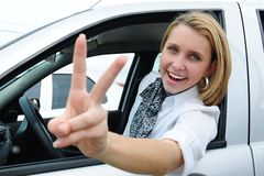 Happy woman driving a new car royalty free stock images