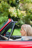 Happy woman driving red cabriolet Stock Image