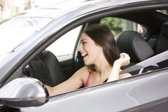 Happy woman driving Royalty Free Stock Image