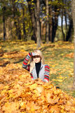 Happy woman drop up leaves in autumn park Stock Image