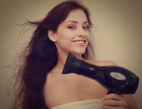 Happy woman drying long hair. Closeup Stock Photo