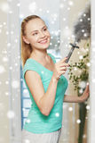 Happy woman with duster cleaning at home Royalty Free Stock Photo
