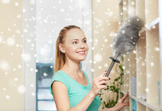Happy woman with duster cleaning at home Stock Photography