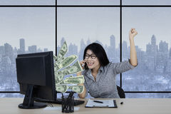 Happy woman earns money from internet Royalty Free Stock Photo
