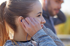 Happy woman with earphones listening to music Stock Photos