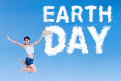Happy woman and Earth Day word Stock Images