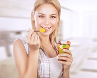 Happy woman eat fruit salad Royalty Free Stock Photos