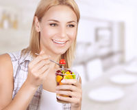 Happy woman eat fruit salad Royalty Free Stock Images