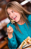 Happy woman eating Royalty Free Stock Image