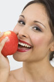 Happy Woman Eating Apple Royalty Free Stock Images