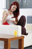 Happy woman eating breakfast Royalty Free Stock Photo