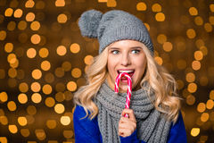 Happy woman eating candy cane Royalty Free Stock Images
