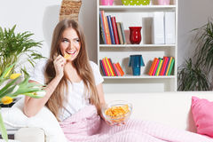 Happy woman eating chips Royalty Free Stock Images