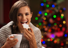 Happy woman eating Christmas cookie Stock Images