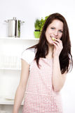 Happy woman eating cucumber Royalty Free Stock Images