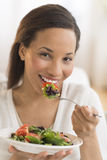 Happy Woman Eating Fresh Salad At Home Royalty Free Stock Images