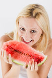Happy woman eating fresh watermelon Stock Images