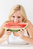 Happy woman eating fresh watermelon stock photography