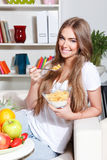 Happy woman eating healthy breakfast Stock Photography