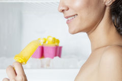 Happy woman eating ice cream Royalty Free Stock Photography