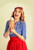 Happy woman eating ice cream,isolated on white. Smiling blonde holds a wafer cone with ice cream in retro style Royalty Free Stock Photos