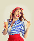 Happy woman eating ice cream,isolated on white. Smiling blonde holds a wafer cone with ice cream in retro style Stock Images