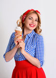Happy woman eating ice cream,isolated on white. Smiling blonde holds a wafer cone with ice cream in retro style Royalty Free Stock Photo