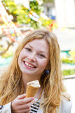 Happy woman eating ice creame Royalty Free Stock Images