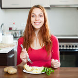Happy  woman eating jacket potatoes Royalty Free Stock Photo