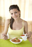 Happy woman eating pasta Royalty Free Stock Photography