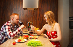 Happy woman eating pasts while man tasting wine Royalty Free Stock Photos