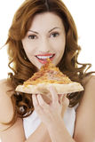 Happy woman eating pizza. Stock Photography