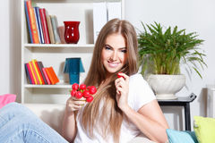 Happy woman eating radish stock images