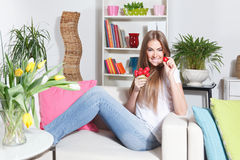 Happy woman eating raw vegetable Royalty Free Stock Images