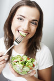 Happy woman eating salad Royalty Free Stock Photos